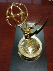 Emmy Award with 2 styles of globes.